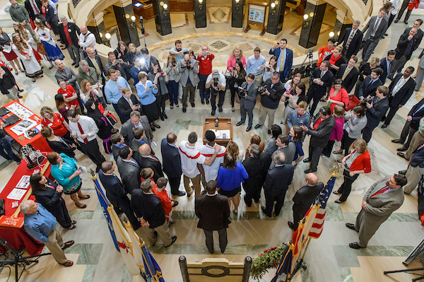 Visitors, legislative staff, legislators and members of the media gather for a visit by UW Badgers basketball players Nigel Hayes and Josh Gasser during UW-Madison Day at the State Capitol on May 6, 2015. The outreach event showcased the work and impact of University of Wisconsin-Madison around the state. (Photo by Bryce Richter/UW-Madison)