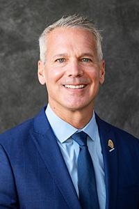 Headshot of Chris Kozina.